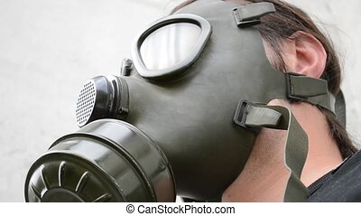 Man With Gas Mask Nod - Gesture of man with a green military...