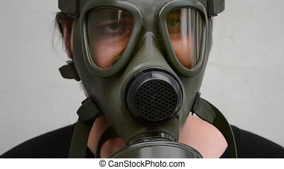 Man With Gas Mask on Face - Frontal view of a man with gas...