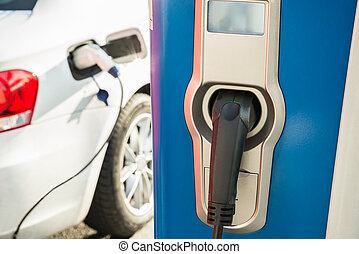 Electric Car Being Recharged - Electric Car Is Being...