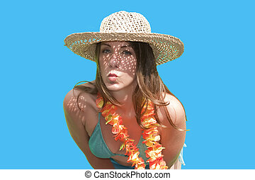 A pretty woman/girl in straw hat posing by blowing a kiss...
