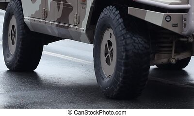 Military SUV - Camouflaged military 4x4 wheels drive...
