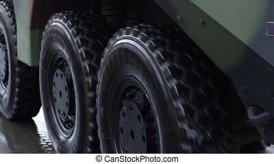 Military Truck Wheels - Close up shot of large black...