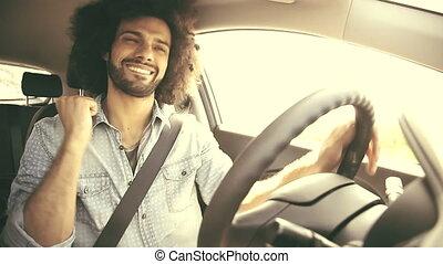 Happy man driving car retro look