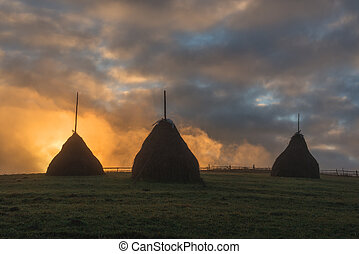 haystack - three haystack in foggy field