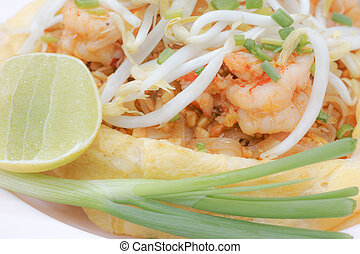 Omelet Padthai with shrimp - Close up of padthai covered by...