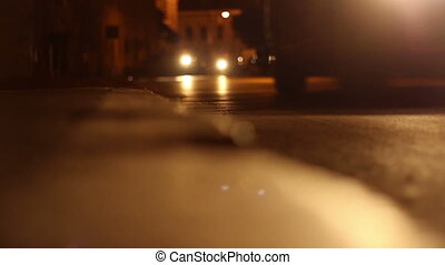Night Riders on Streets - Low angle of two bikers ridding on...