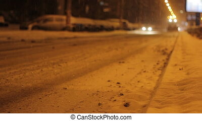 Nighttime Snow Plow Truck - A snow plough machine is...