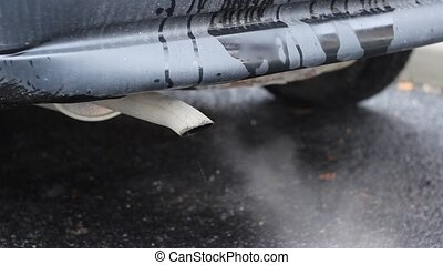 Old Car Pollution - Old used engine, exhaust on the tailpipe...