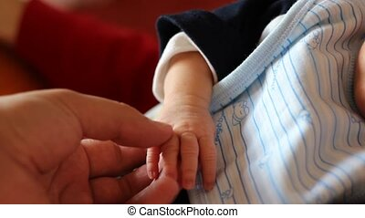 Parent and Baby Tenderness - Affection moment between baby...