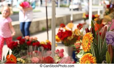 Outdoor Flower Stand - Bunch of colorful flowers, exposed...