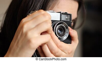 Old Camera Photo Shooting - Girl is taking pictures with a...
