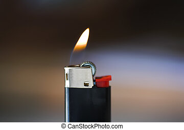 Cigarette Lighter and Flame on a calm blurry background