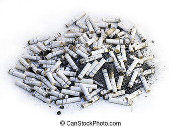 Cigarette Butts - Cigarette butts seen from above on a white...