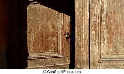 Old Wooden Door is Closing - An old wooden door is closing...
