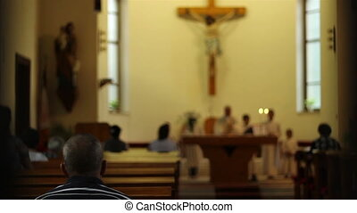 Parishioner Stand Up for Prayer - Man stands up to say...