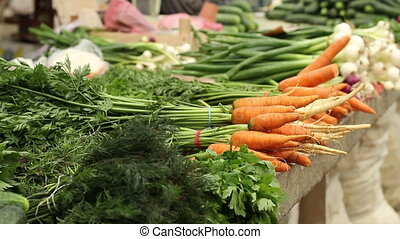 Organic Carrots at Market - Natural greens and carrots with...