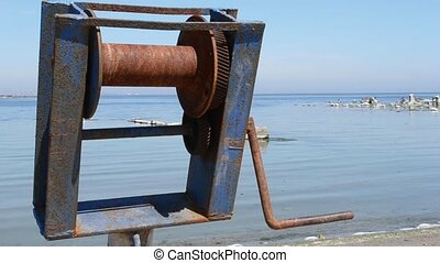 Old Damaged Crank - An old rusty winch, for sea boats, on...