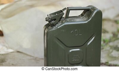 Opening Fuel Canister Cap - A person opens and pick up a...