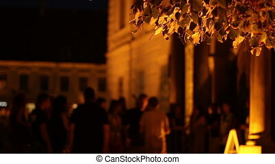 People Entering Queue - People gathered in nighttime in...