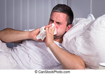 Man Blowing His Nose - Man Infected With Cold And Flu...