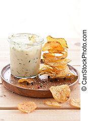 Homemade chips with dip - Homemade potato chips with a glass...