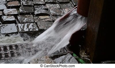 Rainwater Gutter - Lot of rainwater is flowing through the...