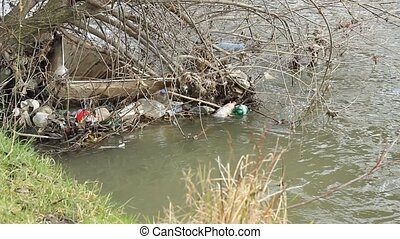 River Garbage Pollution - Water pollution withlastic bottles...