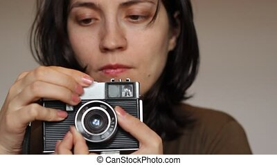 Retro Girl Photographer - Woman is adjusting the exposure...