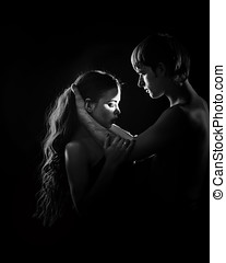 Young couple hugging - Young couple in love hugging each...