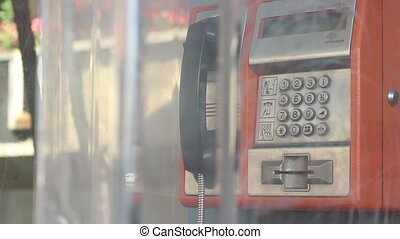 Public Phone Answering Close Up - Close up with a public...