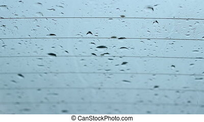 Rain Drops Flatten on Windows - Raindrops collide, drip and...