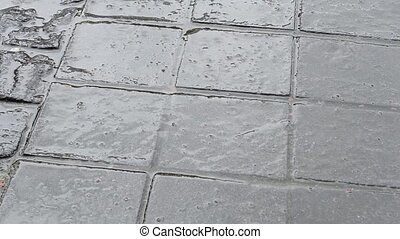 Rain Drops on Paved Street - Rain drops on rectangular tiles...