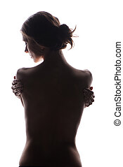 Slim young woman in shadow. Concept for anorexia and diet
