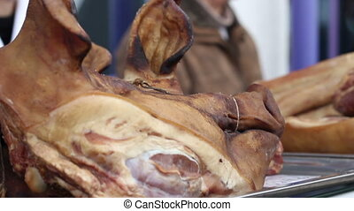Smoked Pig Head - Smoked frightening pork head exposed for...