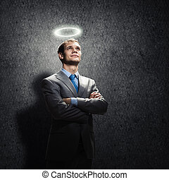 Saint businessman - Young handsome businessman with halo...