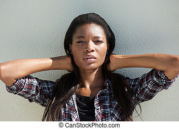 Attractive young african woman with hand in hair - Close up...