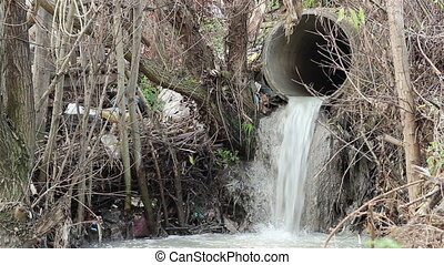 Sewage Polluting Pipe - Waste water with scum flow from city...