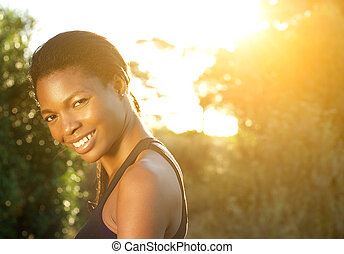 Happy african american woman smiling outdoors - Close up...