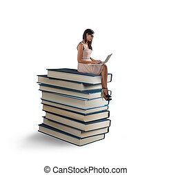 Ebook and big books - A woman reading a ebook on the books