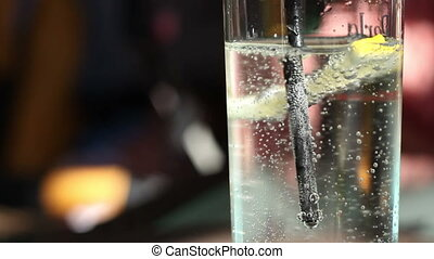 Sparkling Water Glass - Mineral water with lemon mix at bar,...