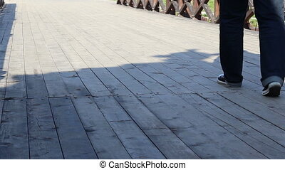 Steps on Wooden Bridge - Someone stepping over wooden boards...