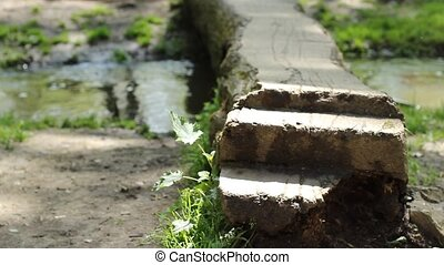 Steps over Footbridge - Low shot of female walking across a...