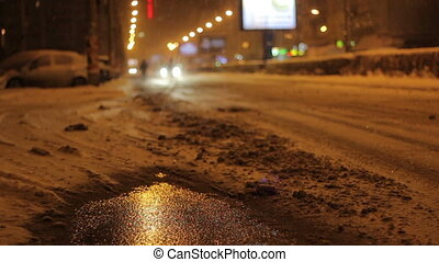 Snowy Night Street Traffic - Bad weather conditions with...