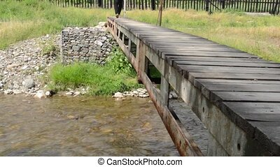Steps on Small Pedestrian Bridge - Pedestrian is crossing a...