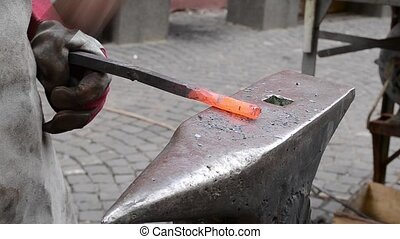 Traditional Manufacturing of Wrough - A blacksmith models a...