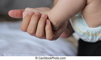 Tiny Baby Foot - A gentle baby foot lovingly caressed the...