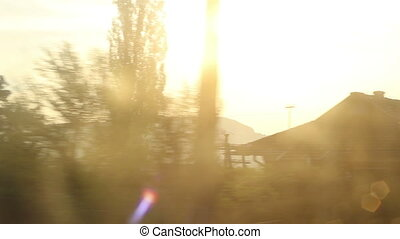 Sun Flashes on Train Window - On the window of a train...