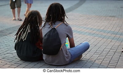 Teenagers Couple with Dreadlocks - A young boy and a girl...