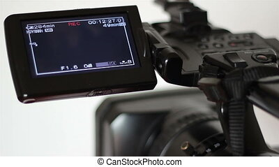 Tape Camera Recording Display - A professional camera on the...