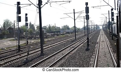 Train Passes Slowly Railroad Yard - A passangers train...